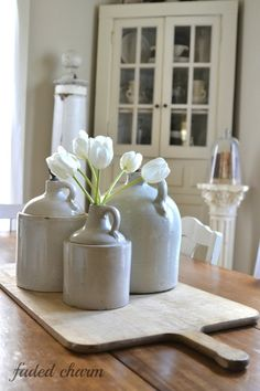 Crock Jugs | Faded Charm blog A grouping of small crocks as a centerpiece!