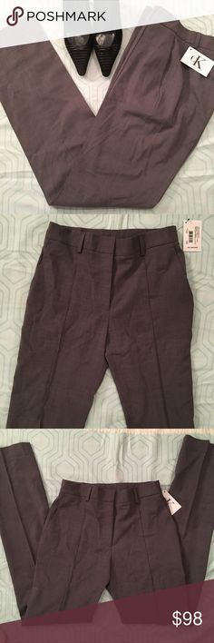 """NWT CK gray trousers Vintage Charcoal Gray CK Calvin Klein wide legged pants. Crease down front legs, belt loops, and Front diagonal slide pockets. No pockets in back. Approx. Measurements taken laying flat and relaxed: waist-26"""", rise-9.5"""", inseam-32"""", thigh-9.5"""", ankle-7"""". 98% wool, 2% spandex.  New with tags. Calvin Klein Pants Trousers"""