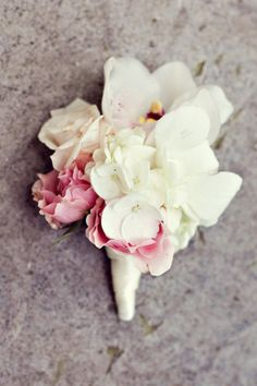 beauty of a boutonnière! complete with hydrangeas, roses and even an orchid!