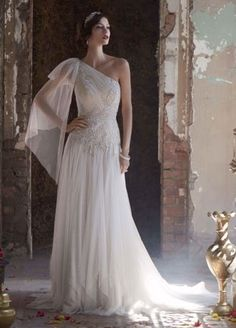 I SAID YES TO THIS DRESS!!! This is the perfect wedding dress to show just how much of a fiercegoddess you are on your special day!  Asymmetrical one shouldersoft net pleated bodice with streamer at sleeve features exquisite beaded embroidered appliques at waist.  Long and soft handkerchief hemline.  Sweep train.