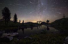 De 19 mooiste ruimtefoto's van dit jaar  Heldergroene lichten boven een Noors meer en een prachtige meteorenregen. Het zijn slechts twee voorbeelden van foto's die genomineerd zijn voor een astrofotografieprijs dit jaar.