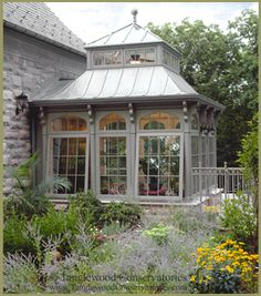 One might easily envision this small hardwood greenhouse to be an elegant conservatory high on its overlooking perch. Instead, the owners will use the south facing room to pot the many specimens that will fill their home.