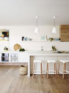 White, wood and subtle color in the kitchen