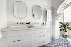 The classic archway is the highlight of this room and helps retain a sense of the home's era. Shower Recess, Walk In Shower, Bathroom Showrooms, Bathroom Renovations, Archway Molding, Herringbone Wall Tile, Boutique Bathroom, Beautiful Bathrooms, Tile Patterns