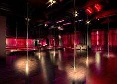 Black, Silver, and HINTS of pink pole room, with dark wood floors. Beautiful!