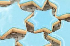 Vegan Royal Icing for Cookies - 1c confectioners' sugar, 2t milk sub, 2t light corn syrup, 1/4t almond or vanilla extract, food coloring as desired - This worked really well on our gingerbread cookies but not for putting together gingerbread houses.