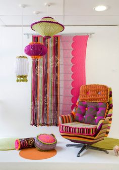 love the ecclectic group of pendants and all the fabrics on the chair and pillows