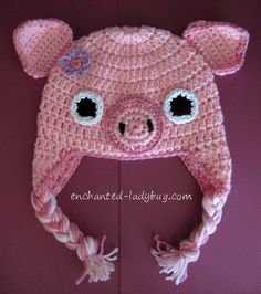 Free crochet pig ear flap hat pattern for kids. Earflap hat pattern with braids featuring a cute pig. Farm animal crochet pattern. Free pdf download