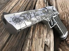 Magnum Research Desert Eagle in Action Express, engraved with a world map on the side. Goodness knows there's enough space on that gun. Very classy!