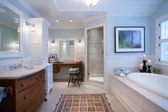 Furniture style in a master bath by Jan Gleysteen Architects.