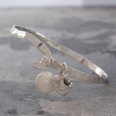 sterling silver hammered heart pearl bangle by otis jaxon silver and gold jewellery | notonthehighstreet.com