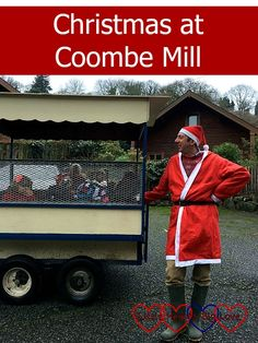 "Farmer Christmas standing next to the children's trailer - ""Christmas at Coombe Mill"""