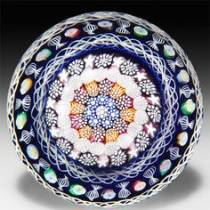 John Deacons 2014 close concentric millefiori mushroom with double torsade magnum paperweight.