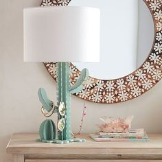 Display Table Lamp With no need for water and always looking for a high-five, this clever cactus-shaped lamp is on point. Crafted from metal and mango wood, its base mimics saguaro and barrel cactus shapes and comes with a classic white linen shade. Home Decor Accessories, Decorative Accessories, Home Crafts, Easy Crafts, Ideas Dormitorios, Cactus Decor, Cactus Lamp, Cactus Cactus, Pastel Decor