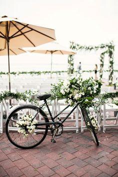 Utterly divine bloom garland covered cruiser bicycle | Chic Red Hook Brooklyn New York Bohemian Wedding | Photograph by Brookelyn Photography  http://www.storyboardwedding.com/chic-red-hook-brooklyn-liberty-warehouse-wedding/