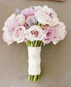 Lavendar wedding bouquet of lisianthus, garden roses and muscari