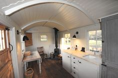 Scandinavian accent Shepherd's Hut. The only problem for full time living is the lack of a bathroom. I'm thinking the far end could be made into a compact bath.