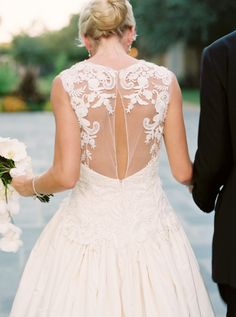 Gorgeous lace-embroidered illusion back wedding dress: http://www.stylemepretty.com/2016/02/12/classic-dallas-wedding-with-a-dream-oscar-de-la-renta-gown/ | Photography: Sarah Kate - http://sarahkatephoto.com/