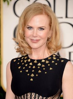 Nicole Kidman: Showing off her new crop, Nicole added some tousled curls to her hairstyle. And to bring out her beautiful eyes, she lined her eyes in baby blue.
