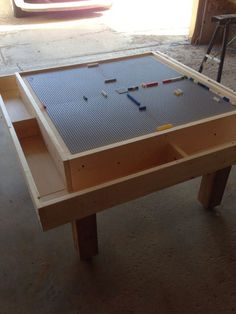 Square Lego Table: Here's a great lego table with a trough for piece collection and a huge building pad!I remembered about halfway through building this table that a is actually so hopefully I've got all my planning numbers adjusted correctly :)