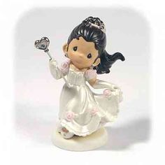 "Precious Moments ® ""La Quinceanera"" Cake Topper Figurine. This porcelain Precious Moments La Quinceanera Porcelain Figurine is traditional yet trendy and would make the perfect Quinceanera cake topper or gift for your brunette's celebration. Make her celebration something that she'll never forget. This lovely wedding figurine may serve as a perfect addition for your guestbook table, or to crown the top of your birthday cake. It also makes a great gift!"