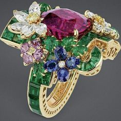'Orangerie Rubellite' ring in white gold with emeralds, rubellite, white diamonds yellow, blue and pink sapphires, Paraiba-like tourmaline and yellow diamonds from the 'À Versailles Côté Jardins' collection by Victorie de Castellane for Dior Haute Joaillerie ✨✨ .