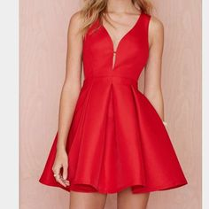 Red dress - currently on wait list! Red fit and flare dress with low cut sides. No trades! Nasty Gal Dresses Mini