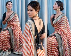 Hina Khan graced the India Day Parade in New York. For the event, the television actress opted for a striped black, white and orange banarasi silk saree by Rajyalakshmi Heritage Banaras. Casual Indian Fashion, Indian Fashion Dresses, Indian Designer Outfits, Trendy Sarees, Stylish Sarees, African American Women Hairstyles, Bridal Anarkali Suits, Saree Hairstyles, Pattu Saree Blouse Designs