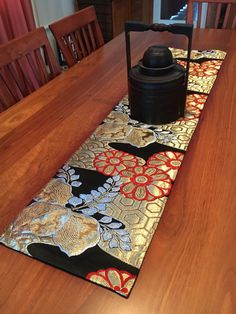 A personal favourite from my Etsy shop https://www.etsy.com/au/listing/386827144/vintage-japanese-obi-table-runner-black