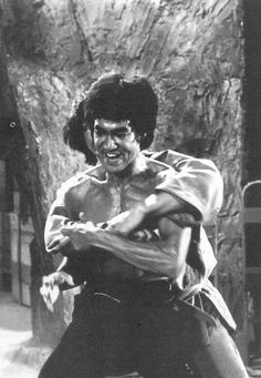 """""""Bruce Lee In Enter The Dragon Utilizing The A Counter To A Rear Grab And At This Point He Begins To Flow From A Rear RT,  Elbow Strike After Which He Flow Into The Hammer Lock Technique or Concept He'd Traded With Professor Wally Jay, i.e., Founder of Small Circle Jui-Jutisu !"""""""