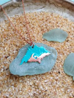 Upper Peninsula Pendant with Lake Superior by sprout1world on Etsy. In copper.