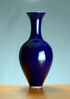 Wheel thrown porcelain fluted blue vase with an elegant foot. High fired, cone 10. Ceramic vase | Caldwell Pottery