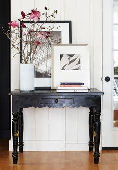 Lovely & slightly worn black table and easy display.