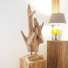 This impressive Abstract Wood Sculpture On Stand looks impressive used as a feature both indoors or outside. Make great hallway features or use to decorate the garden!  Constructed from a solid piece of teak root, this item creates a real statement, especially where you wish to promote your sustainability credentials. Each piece is completely individual and free standing. The image shown is of the item that you will receive!   s