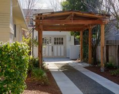 Exterior, Simple Ordinary Concrete And Pebble Road To The Garage With The Wood Pergola Outside The House Building: Artistic Pergola Design I. Diy Pergola, Pergola Carport, Retractable Pergola, Wood Pergola, Small Pergola, Pergola Canopy, Cheap Pergola, Pergola Shade, Pergola Ideas