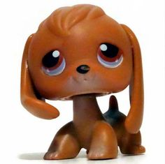 LPS#0016 BEAGLE Dog, brown, sorrowful eyes and hair that is a darker shade of brown than the rest of its body.  Appeared on the game board monopoly illustrations with 6 other pets