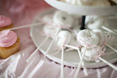 Cute way to dress up mini powdered donuts! Add a stick and a cute bow. Less mess…
