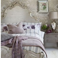 Very pretty bedroom with grays, silver, white and subtle purple shades but you could accent it with any color.