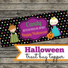 Candy never bothered me anyway... but candy topped with a cute printable is ever better!    Frozen Halloween treat bag toppers!