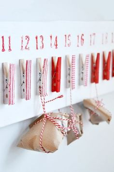 Stencil the numbers, cover the clothes pins with cute fabric;  wrap small gifts in kraft paper and simple colored cord. Beautifully simple.