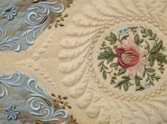 "Radiance detail - Susan Stewart won the Pfaff Master Award for Machine Artistry for her quilt, ""Radiance."" It features digitized machine embroidery and also digitized free standing lace insets along the border. She did free motion machine quilting and achieved some beautiful trapunto effects. Maria Elkins.com"