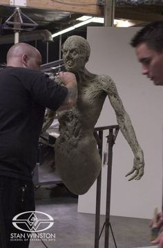 Character Creation artists John Cherevka and Jason Matthews sculpt the hero Stan Winston Studio Tooth Fairy puppet for DARKNESS FALLS.