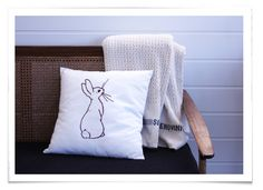 love the simplicity of this cushion and the blanket looks idea for some couch reading ... old worldy, vintage charm :)
