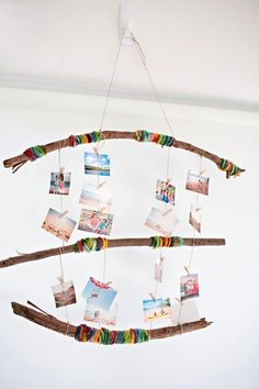 With a few sticks, yard, and some glue, your kids can help you create this Yarn Wrapped Photo Mobile! We think this DIY craft would be the perfect addition to your little one's room or playspace. Twig Crafts, Nature Crafts, Craft Stick Crafts, Crafts For Kids, Reggio Emilia, Composition Photo, Wrapped Sticks, Photos Encadrées, Kids Wraps