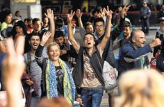Sept 6, 2015 SEAN GALLUP/GETTY IMAGES Migrants arriving to cheers in Munich on Saturday at the city's main railway station after an arduous journey through Europe.