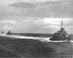 Three of the U.S. Navy Destroyer Squadron 21's ships underway steaming in column, while en route to Guadalcanal and Tulagi on 15 August 1943, following the Vella Lavella landings. The ships are (from front to rear): USS O'Bannon (DD-450), USS Chevalier (DD-451) and USS Taylor (DD-468). Photographed from USS Nicholas (DD-449).