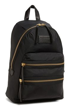 Winter Style Ideas. Winter Fashion and Winter Outfit Ideas. Black Marc by Marc Jacobs Backpack with Brass Hardware.
