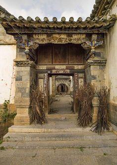 Old Chinese traditional gate At Tuan Shan Village, Yunnan Province, China