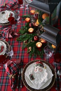 Santa Christmas Plaid table with Royal Stewart Tartan, Santa plates and fruit, pine cone and greenery filled lanterns | Home is Where the Boat Is #tartan #table #Christmas