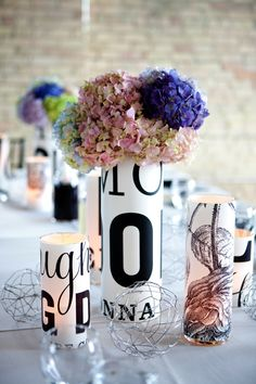 Vases wrapped in printed cardstock + vellum